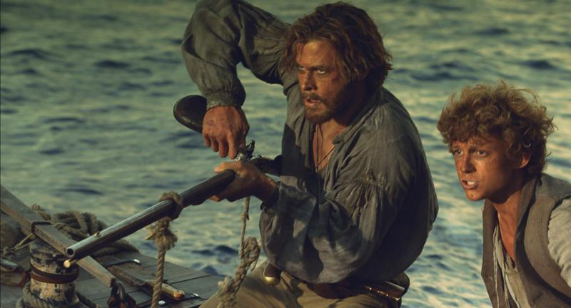 "Chris Hemsworth and Tom Holland star in a scene from the movie ""In the Heart of the Sea.""(CNS photo/Warner Bros.)"