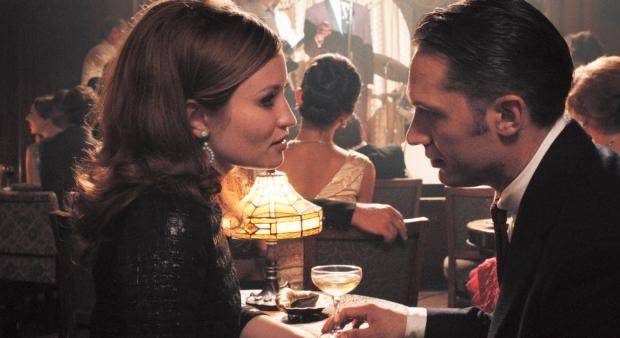 """Emily Browning and Tom Hardy star in a scene from the movie """"Legend."""" (CNS photo/Universal)"""