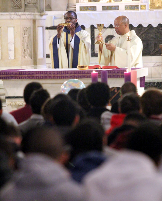 Fr. Richard Owens O.F.M., alumni of Mercy High School, and Fr. Stephen Thorne concelebrate Mass.