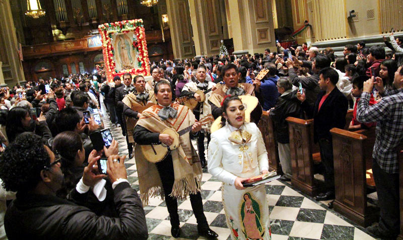 El Mariachi Flores leads the procession of images of Our Lady of Guadalupe before Mass.