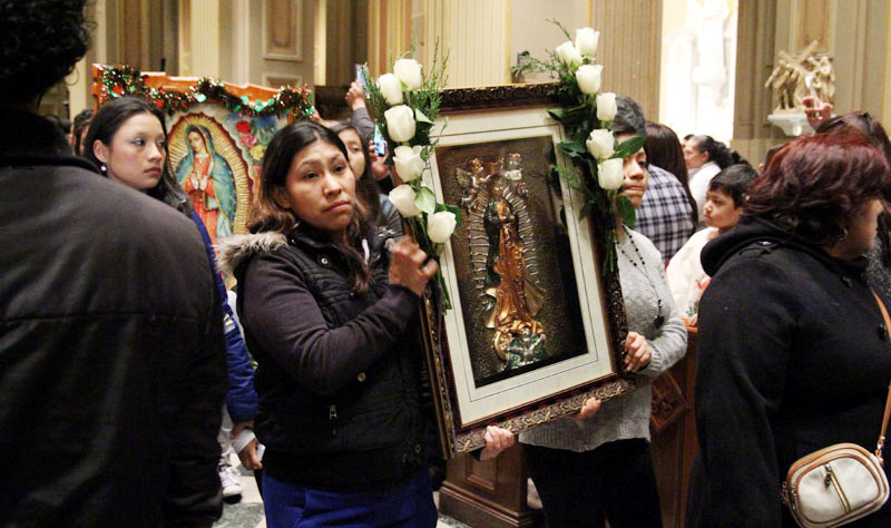 A variety of images of Our Lady of Guadalupe were part of the procession before Mass.
