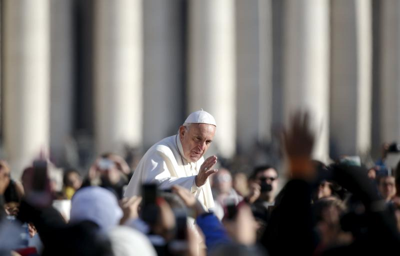 Pope Francis waves as he arrives to lead his weekly audience in St. Peter's Square at the Vatican Dec. 2. (CNS photo/Alessandro Bianchi, Reuters)