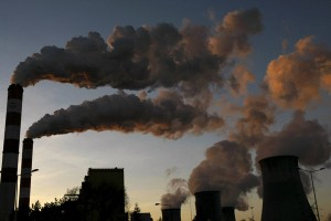 """Smoke billows from the chimneys of power plant in 2014 in Belchatow, Poland. Heads of state discussing carbon emission limits must create a global and """"transformative"""" agreement built on justice, solidarity and fairness, a papal representative told the U.N. climate change conference Nov. 30 in Paris. (CNS photo/Kacper Pempel, Reuters) See COP21-VATICAN-PAROLIN Dec. 1, 2015."""