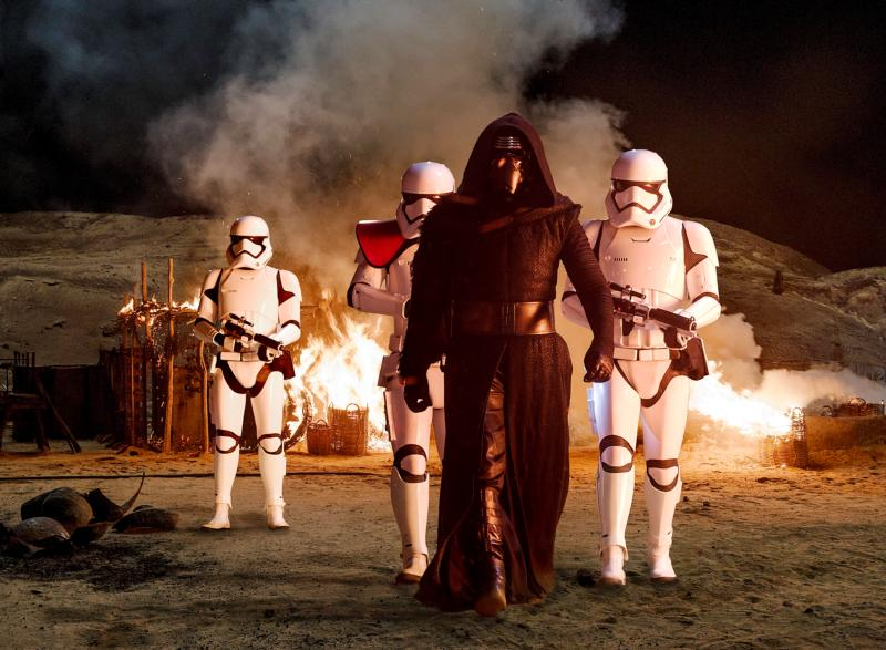 """Adam Driver, who plays villain Kylo Ren, stars in a scene from the movie """"Star Wars: The Force Awakens.""""  In a recent movie review, the Vatican newspaper L'Osservatore Romano says Star Wars villains are not evil enough. (CNS photo/Disney)"""