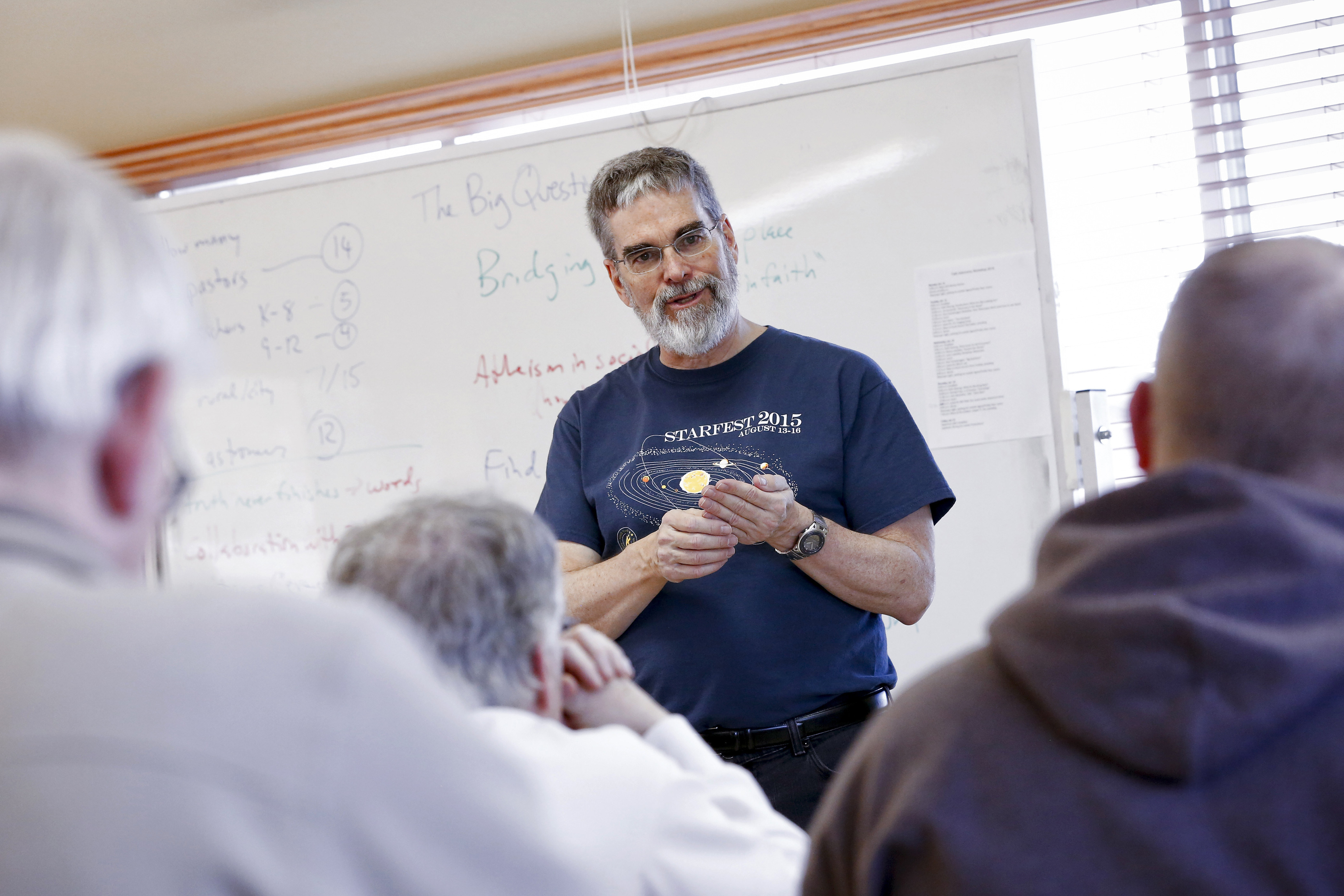 Jesuit Brother Guy Consolmagno, director of the Vatican Observatory, facilitates the Faith and Astronomy Workshop Jan. 13 at the Redemptorist Renewal Center in Tucson, Arizona. (CNS photo/Nancy Wiechec)