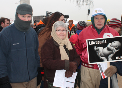 From left, Patrick, Agnes and John Blisard stay warm while participating in the March for Life Jan. 22 in Washington, D.C.