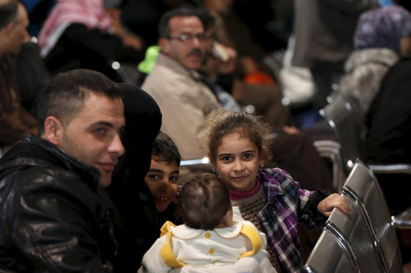 Syrian refugees wait to register at the office of the U.N. High Commissioner for Refugees in Amman, Jordan, Dec.  11. More than 1,000 Syrian refugees in Jordan were interviewed for a potential chance to go to Canada. (CNS photo/Muhammad Hamed, Reuters)