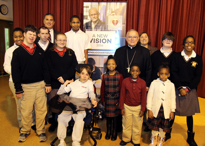 Archbishop Chaput poses with students of St. Katherine Day School, Wynnewood. (Sarah Webb)