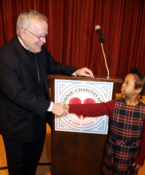 Archbishop Chaput greets a young student of St. Katherine Day School, Wynnewood. (Sarah Webb)