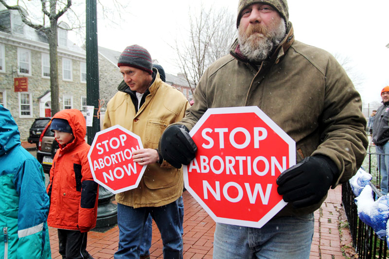 ProLife supporters from Chester County silently march in the snow from Saint Agnes Church in West Chester to the steps of the Chester Courthouse.