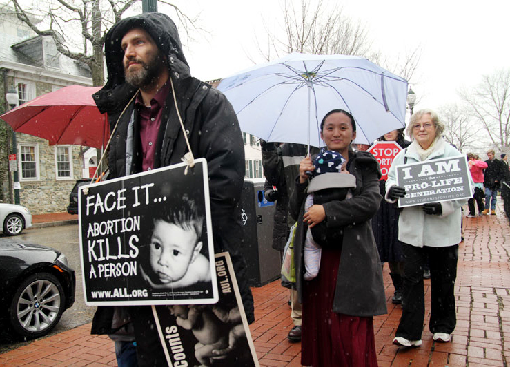 ProLife supporters of all ages from Chester County silently march in the snow from Saint Agnes Church in West Chester to the steps of the Chester Courthouse.