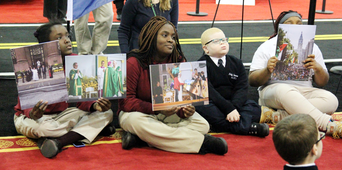 Special needs students help tell the story of Pope Francis' visit by  holding pictures from The World Meeting of Families.