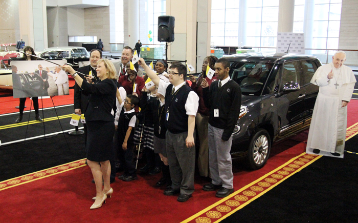 Donna Farrell, Executive Director for the World Meeting of Families – Philadelphia 2015, takes a selfie with Bishop John J. McIntyre, David Kelleher, Chairman of the 2016 Philadelphia Auto Show, and students from the special needs schools of the Archdiocese of Philadelphia.