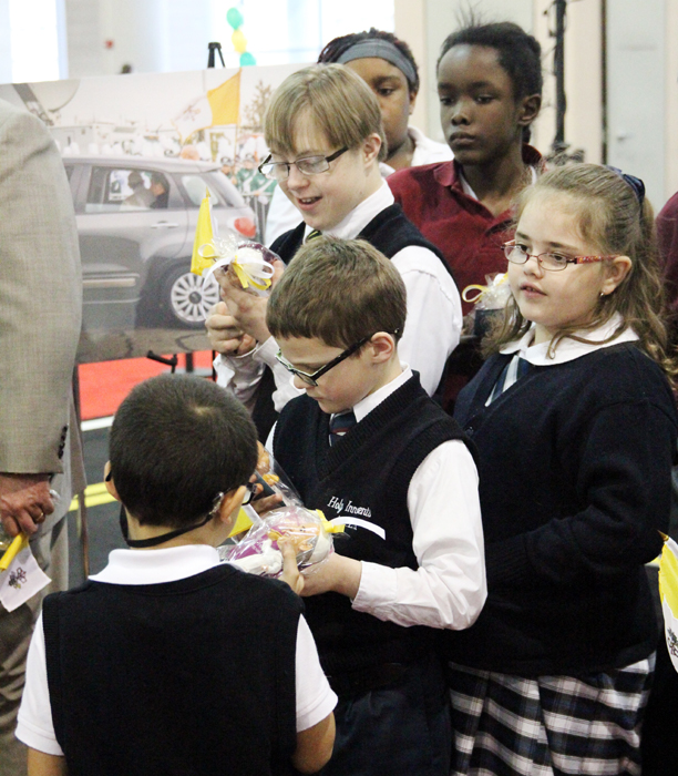 Students received bobblehead dolls of Pope Francis after they got a tour of the Fiat he rode in while in Philadlephia.