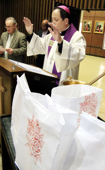 Auxiliary Bishop of Philadelphia John McIntyre blesses luminaries to be placed outside the Archdiocesan Pastoral Center in Philadelphia to remind passersby of the sanctity of life on the eve of the March for Life in Washington, D.C.