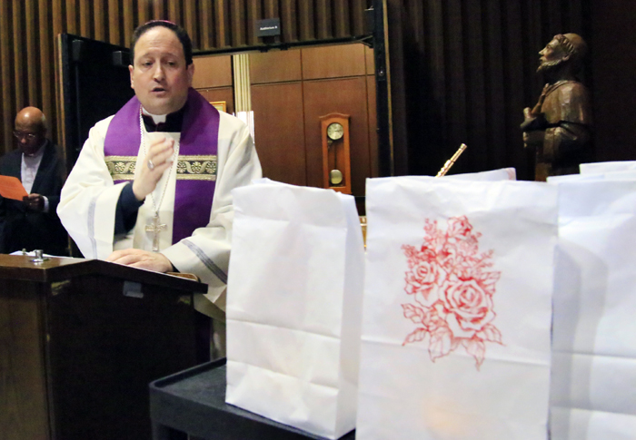 Auxiliary Bishop of Philadelphia John McIntyre blesses luminaries to be placed outside the Archdiocesan Pastoral Center in Philadelphia to remind passersby of the sanctity of life on the eve of the March for Life in Washington, D.C. (Photo by Sarah Webb)