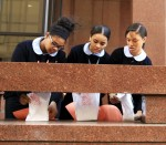 Students from John W. Hallahan Catholic Girls' High School place luminaries for life at the Archdiocesan Pastoral Center along a wall facing 17th Street in Philadelphia.