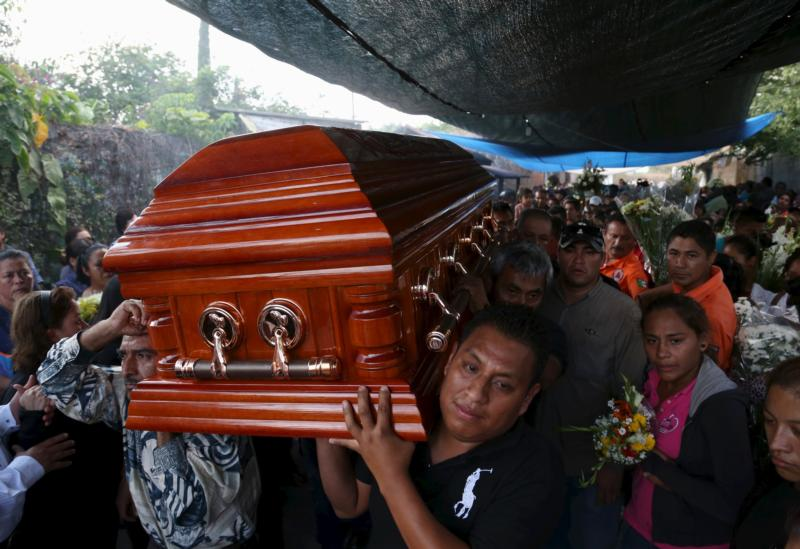 The coffin of Gisela Mota, former mayor of Temixco, Mexico, is carried out of her home Jan. 3. Mota was killed Jan. 2, one day after taking oath of office.  (CNS photo/Margarito Perez, Reuters) See MEXICO-MAYOR-MOTA-CRIME Jan. 4, 2015.