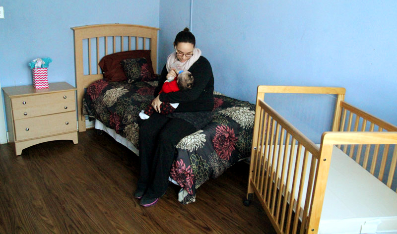 Hannah Kaskey feeds her daughter Sabrina in the comforting room at Mother's Home.