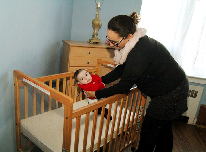 Hannah Kaskey lays her daughter Sabrina down for a nap at Mother's Home in Darby, Delaware County.
