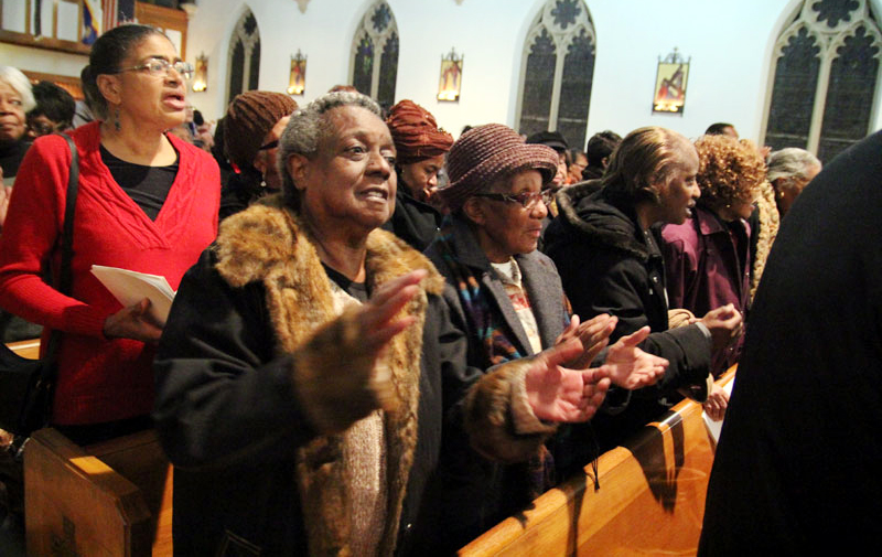 Marva Murray from Our Lady of Hope Church Philadelphia claps and signs along in praise.