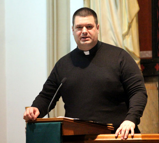 Father Tom Whittingham welcomes parishoners and guests to Saint Katherine Drexel Church for the MLK service.