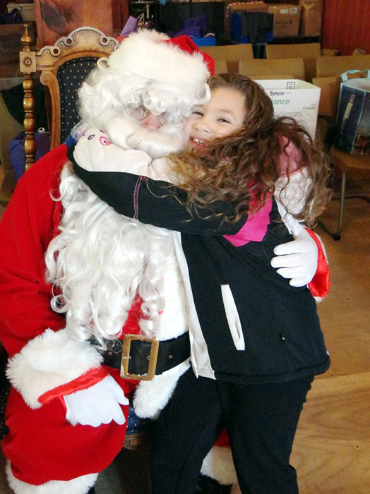 Children from the community were overjoyed when Santa came to visit Mother of Mercy House's Christmas celebration.