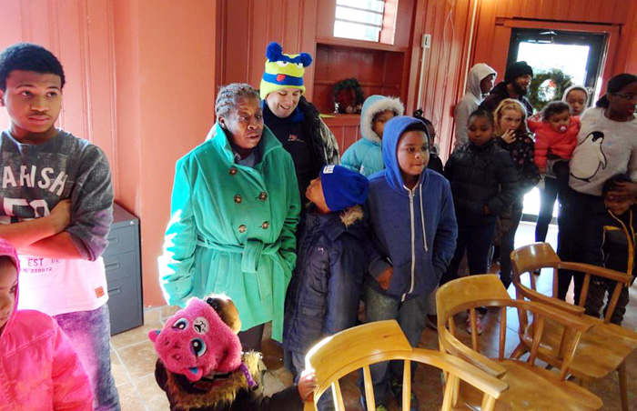 Members of the community come out for a Christmas celebration at Mother of Mercy House.