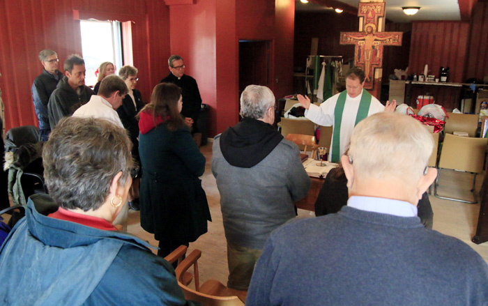 Father Joseph Devlin, co-coordinator of Mother of Mercy House, celebrates daily Mass Jan. 26 in the mission.