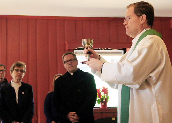Father Joseph Devlin celebrates Mass as Sr Ann Ryamond Welte, IHM and Father Liam Murphy pray.  Mass is celebrated Tuesday thorugh Friday at noon at Mother of Mercy House.