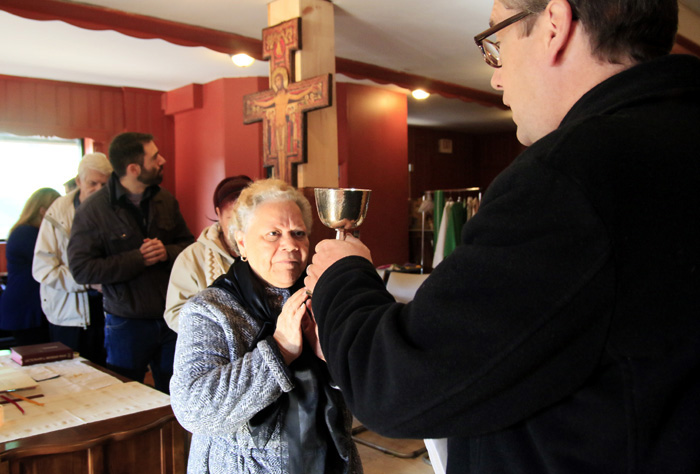 Fr Liam Murphy offers the blood of Christ.