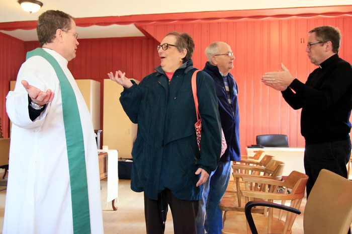 Father Joseph Devlin and Father Liam Murphy chat with guests after Mass.