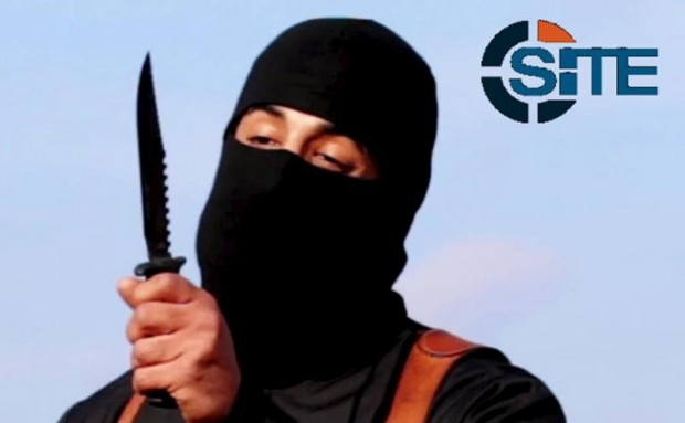 A masked, black-clad militant, identified as a Briton named Mohammed Emwazi, brandishes a knife in this still image from a 2014 video. Cardinal Vincent Nichols of Westminster planned to tell delegates at a London conference Jan. 28 to guard against the Internet recruitment of vulnerable secondary school students by the Islamic State group. (CNS photo/SITE Intel Group Handout via Reuters)