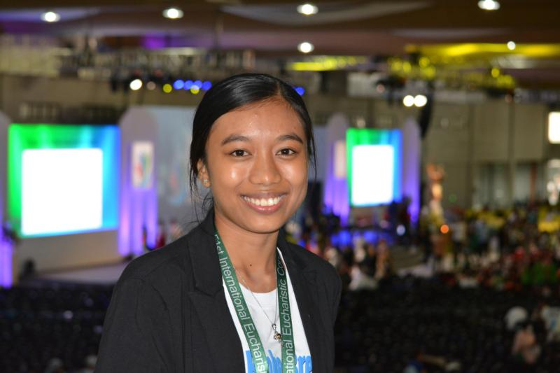 "Former garbage scavenger turned mentor to street children Maria Georgia ""Maggie"" Cogtas is pictured Jan. 29 at the 51st International Eucharistic Congress in Cebu, Philippines. Cogtas moved many in the audience of more than 12,000 to tears when she told of a childhood without playing, only tough work as a garbage picker at dumpsites, construction sites and on the streets. (CNS photo/Simone Orendain)"
