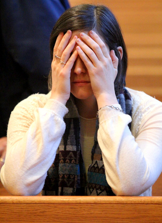 Rachel DaRos, who is a member of The Culture Project, prays for the unborn during Mass at the ProLife Summit.