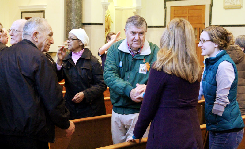 Fellow ProLife supporters offer one another a sign of peace during the ProLife Summit at the Cathedral Basillica of SS Peter and Paul in Philadelphia.