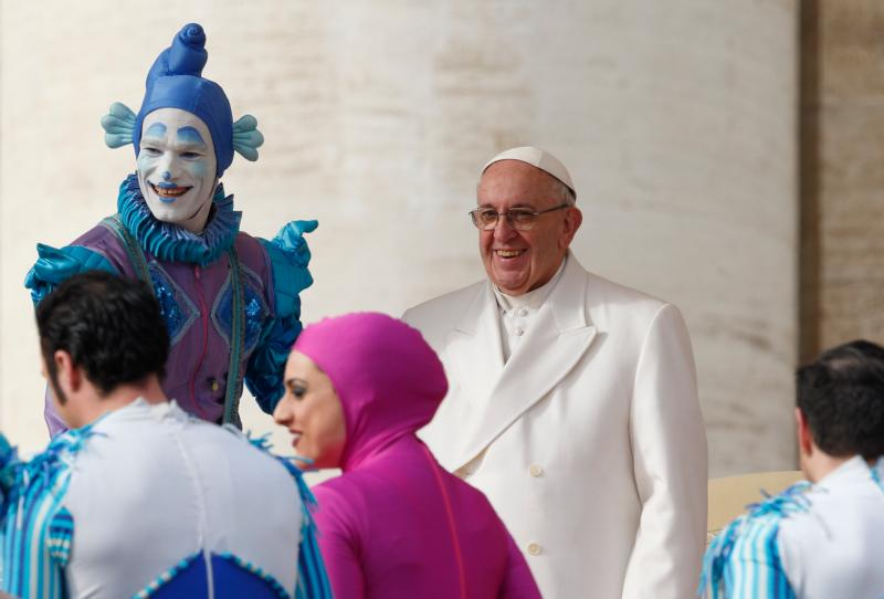 Circus members greet Pope Francis after their performance during the pope's general audience in St. Peter's Square at the Vatican Jan. 27. (CNS photo/Paul Haring)