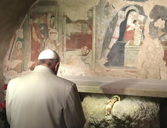 Pope Francis prays in front of a Nativity scene during a Jan. 4 surprise visit to the  Franciscan shrine in Greccio, Italy. (CNS photo/L'Osservatore Romano, handout via EPA)