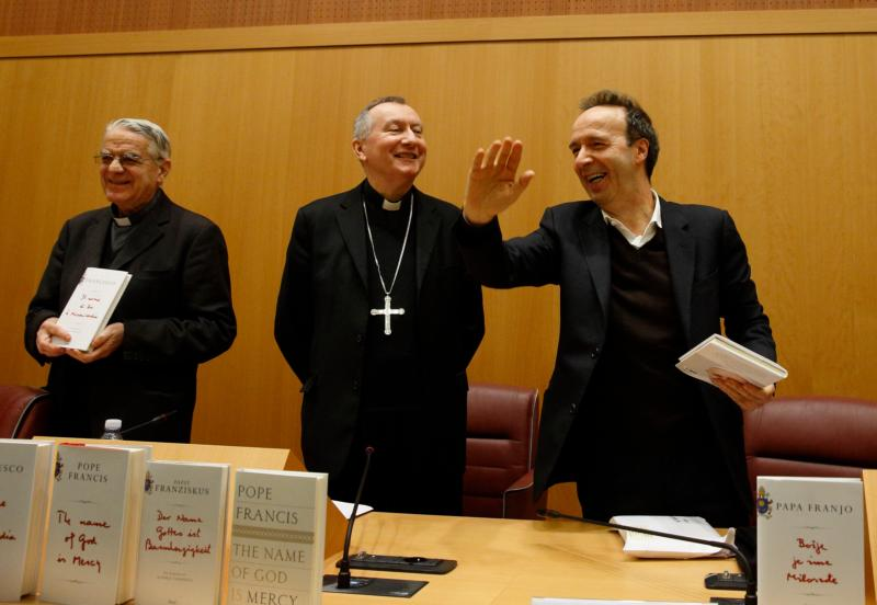 "Jesuit Father Federico Lombardi, papal spokesman, Cardinal Pietro Parolin, Vatican secretary of state, and Italian actor Roberto Benigni arrive for the presentation of ""The Name of God Is Mercy"" to journalists in Rome Jan. 12. (CNS photo/Paul Haring)"