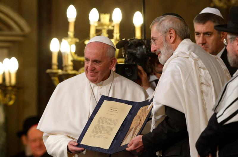 Pope Francis and Rabbi Riccardo Di Segni, the chief rabbi of Rome, hold a codex containing five pages of Jewish biblical commentary during the pope's visit to the main synagogue in Rome Jan. 17. The 14th century codex was the pope's gift to the Jewish community of Rome. (CNS photo/Paul Haring)