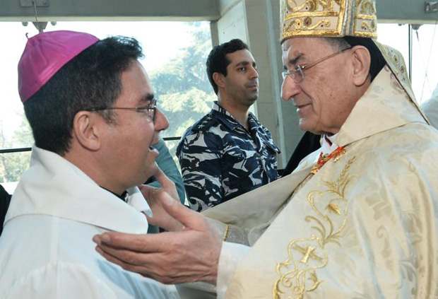 Bishop Oscar Cantu of Las Cruces, New Mexico, chairman of the bishops' Committee on International Justice and Peace, greets Lebanese Cardinal Bechara Rai, patriarch of the Maronite Catholic Church, Jan. 17. They concelebrated Mass for migrants and refugees at the basilica of Our Lady of Lebanon in Harissa. (CNS photo/Mychel Akl for Bkerke, the Maronite Catholic patriarchate)