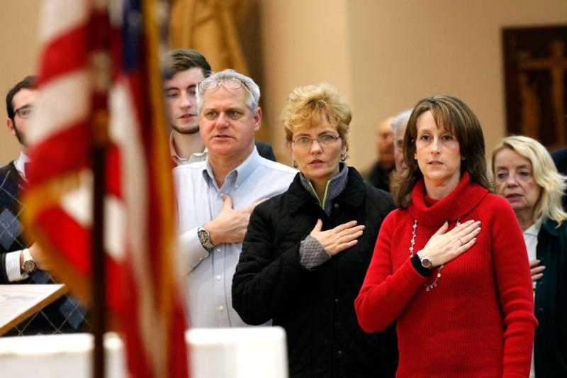 People recite the Pledge of Allegiance at the beginning of a presentation on religious freedom and conscience rights Jan. 3 at St. Patrick Church in Smithtown, N.Y. The event was sponsored by Catholics for Freedom of Religion. (CNS photo/Gregory A. Shemitz)