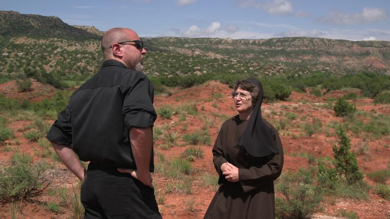 "Deacon Pedro Guevara-Mann, producer and host of a six-part series called ""Creation,"" speaks with Franciscan Sister Damien Marie Savino, on a filming site at Palo Duro Canyon, Texas. Sister Damien is the chair of the Department of Environmental Studies and Sciences at the University of St. Thomas in Houston. (CNS Photo/Courtesy Salt and Light Catholic Media Foundation)"