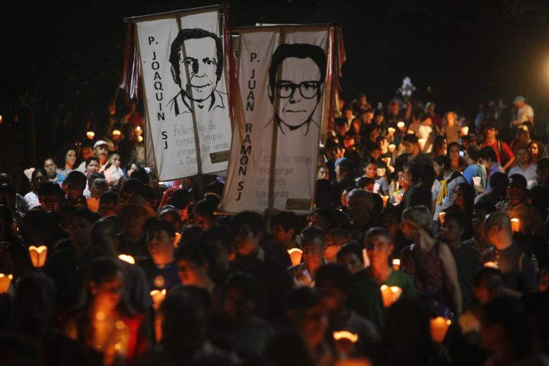 "People participate in the ""little lanterns march"" at the Central American University in San Salvador during the 2015 commemoration of the 26th anniversary of the massacre of six Jesuit priests and two women, murdered in November 1989 by a military commando. (CNS photo/Oscar Rivera, EPA)"