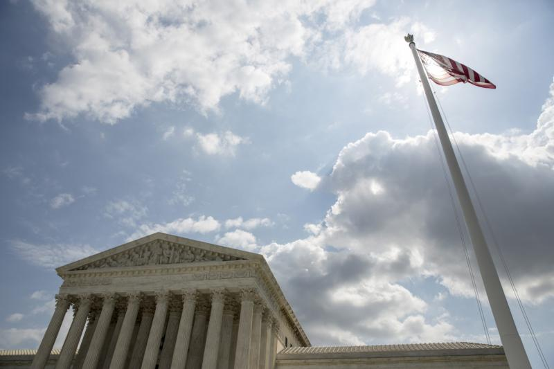 The U.S. flag flies in front of the Supreme Court in Washington in this file photo from May 18, 2015. (CNS photo/Joshua Roberts, Reuters)
