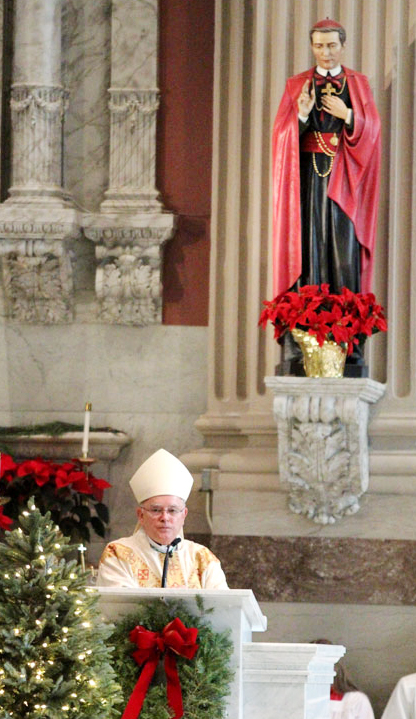 Archbishop Charles Chaput preaches the homily during Mass. (Sarah Webb)