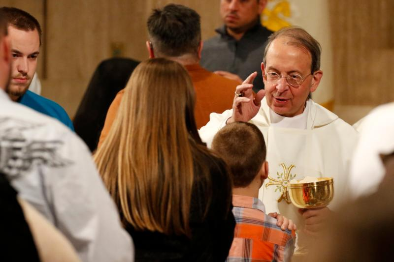 Baltimore Archbishop William E. Lori blesses a boy while distributing Communion during the opening Mass of the National Prayer Vigil for Life at the Basilica of the National Shrine of the Immaculate Conception in Washington Jan. 21.(CNS photo/Gregory A. Shemitz)