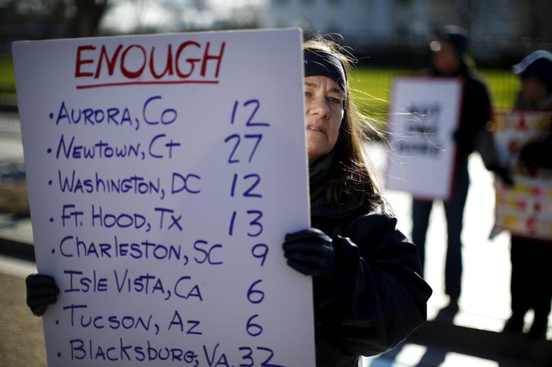 Gun control activists rally in front of the White House in Washington Jan. 4. The next day, U.S. President Barack Obama announced executive actions to reduce gun violence. (CNS photo/Carlos Barria, Reuters)