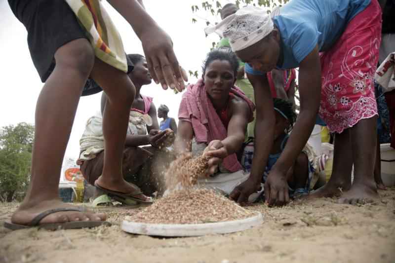 Villagers gather food Jan. 15 at a distribution point near Harare, Zimbabwe. With poverty on the rise and a drought compounding Zimbabwe's problems, people are struggling to make ends meet and the poor are becoming poorer, church workers said. (CNS photo/Aaron Ufumeli, EPA)