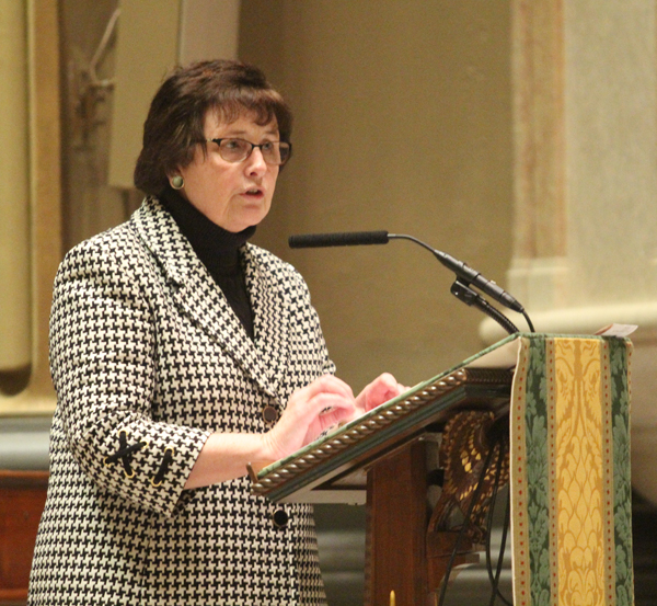Ann Menna, deputy secretary for catechetical formation in the Archdiocese of Philadelphia, presents each awardee in the Cathedral Basilica of SS. Peter Paul on Sunday, Jan. 17.